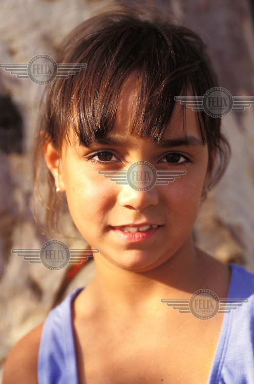 Eight year old Alexis Abala, who is half Aboriginal.  She lives with her white mother and stepfather.