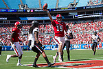 Ryan Finley (15) of the North Carolina State Wolfpack scores a touchdown on a 6-yard run during first half action against the South Carolina Gamecocks in the Belk College Kickoff at Bank of America Stadium on September 2, 2017 in Charlotte, North Carolina.  The Gamecocks defeated the Wolfpack 35-28.  (Brian Westerholt/Four Seam Images)