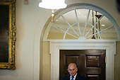 John Kelly, White House chief of staff, listens as U.S. President Donald Trump speaks during a lunch meeting with Republican lawmakers, in the Cabinet Room at the White House in Washington, D.C., U.S., on Tuesday, June 26, 2018. <br /> Credit: Al Drago / Pool via CNP