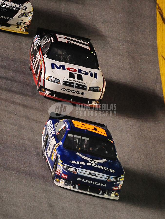 Jul. 3, 2010; Daytona Beach, FL, USA; NASCAR Sprint Cup Series driver Elliott Sadler (19) leads Sam Hornish Jr. (77) during the Coke Zero 400 at Daytona International Speedway. Mandatory Credit: Mark J. Rebilas-