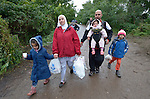 Refugees on their way to western Europe, a family from Damascus, Syria, approaches the border into Croatia near the Serbian village of Berkasovo.