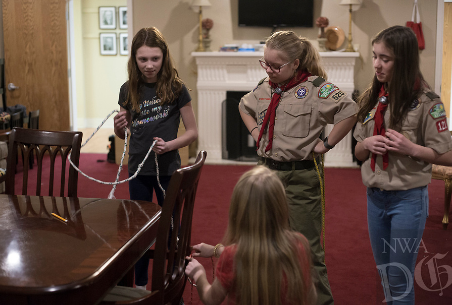 """NWA Democrat-Gazette/CHARLIE KAIJO Ruby Freeman and Annabella Rose Tyburski (from right) observe as Ava Ahern (left) and Stella Decker (bottom) learn how to tie different knots during a family scouting open house, Monday, February 4, 2019 at First United Methodist Church in Bentonville. Like Ruby, Annabella also grew up learning about Scouts from her brother. """"It made me feel like I really wanted to do it because I couldn't participate in the merit badges,"""" she said."""