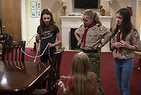 "NWA Democrat-Gazette/CHARLIE KAIJO Ruby Freeman and Annabella Rose Tyburski (from right) observe as Ava Ahern (left) and Stella Decker (bottom) learn how to tie different knots during a family scouting open house, Monday, February 4, 2019 at First United Methodist Church in Bentonville. Like Ruby, Annabella also grew up learning about Scouts from her brother. ""It made me feel like I really wanted to do it because I couldn't participate in the merit badges,"" she said."