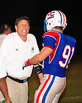 Head Coach J.T. Curtis of the John Curtis Patriots during their 34-7 defeat of Newman.  The Patriots have won 23 Louisiana State Championships during his head coaching tenure.