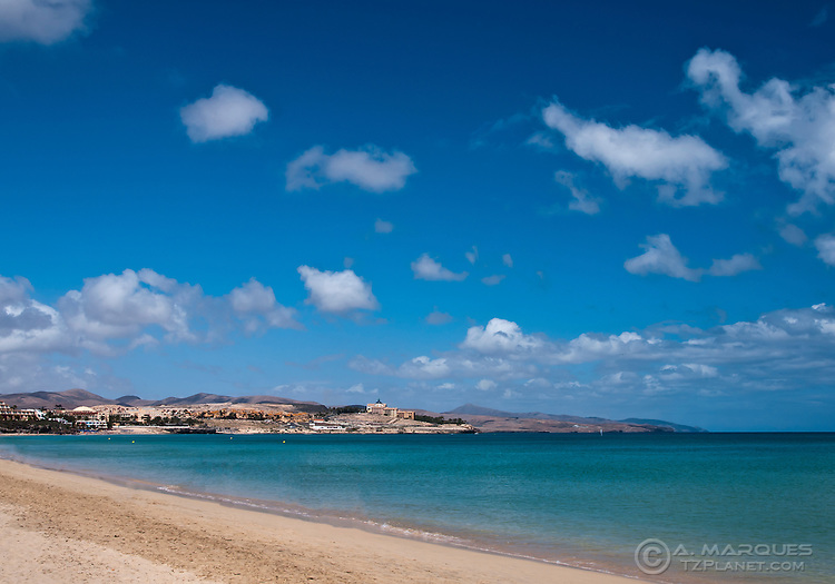The beach of Costa Calma, Fuerteventura, Canary Islands, Spain. The beach, like its name Quiet Shore, is very peaceful, and not too overcrowded. This beach resort is very popular with german tourists, visible also by the german influence in local restaurants and shops.