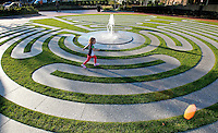 Boston, MA  -  Elizabeth Kelliher, 3, of Salem, MA takes a tour of the Armenian Heritage Park which includes a labyrinth of grass and stone on the Rose Kennedy Greenway on Monday, September 17, 2012.