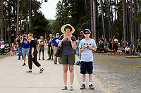 People watch as Old Faithful erupts in Yellowstone National Park, Wyoming, USA. In the days surrounding when this image was taken, the geyser averaged an eruption about every 90 minutes, though occasionally there were hours between eruptions.