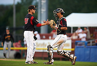Batavia Muckdogs pitcher Steven Farnworth (55) and catcher Brad Haynal (23) shake hands after closing out a game against the West Virginia Black Bears on August 30, 2015 at Dwyer Stadium in Batavia, New York.  Batavia defeated West Virginia 8-5.  (Mike Janes/Four Seam Images)