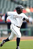 NW Arkansas Naturals outfielder Edinson Rincon (16) runs to first during a game against the Corpus Christi Hooks on May 26, 2014 at Arvest Ballpark in Springdale, Arkansas.  NW Arkansas defeated Corpus Christi 5-3.  (Mike Janes/Four Seam Images)