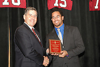 14 January 2007: Bob Bowlsby presents an award to Thaddeus Chase Jr. at the annual football banquet at McCaw Hall in Stanford, CA.