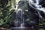 Man under waterfall at Rincon de la Vieja National Park, Costa Rica