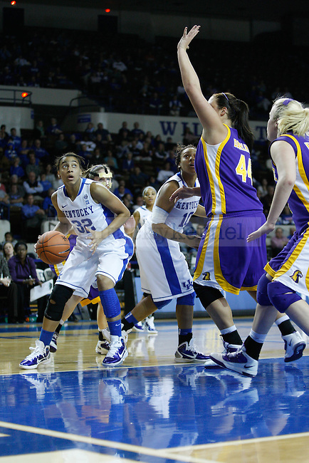 UK guard, Kastine Evans dribbles down the base-line in the game against Tennessee Tech at Memorial Coliseum on December 7, 2010. Photo by Ryan Buckler | Staff