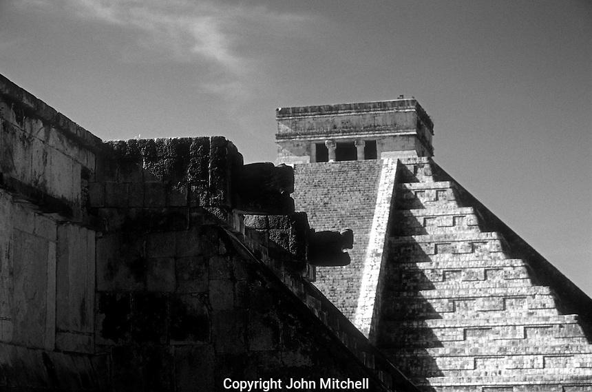 Venus Platform and El Castillo or Pyramid of Kukulcan framed by trees, Chichen Itza, Yucatan, Mexico