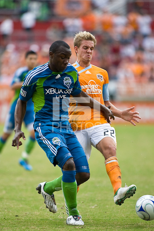Seattle Sounders defender Jhon Kennedy Hurtado (34) and Houston Dynamo midfielder Stuart Holden (22) fight for control of the ball.  Houston Dynamo defeated Seattle Sounders FC with an aggregate score of 1-0 in the second leg of the Western Conference semifinals at Robertson Stadium in Houston, TX on November 8, 2009.