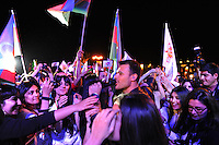 Emin Agalarov, the son-in-law of Azerbaijan's President Ilham Aliyev and the nation's top male pop star, enters the crowd for a moment after exiting the stage to join his front row fans during a performance on the Caspian seaside Bulvar at the Eurovsion Song Contest Fan Club concert on April 29, 2012.  Agalarov is married to Leyla Aliyeva, the eldest daughter of Azerbaijani President Ilham Aliyev who holds many hats in her own right, among them head of the Heydar Aliyev Foundation in Russia, editor of Baku Magazine, artist, and poet and Agalarov's father, Aras Agalarov, is a Russian billionaire oligarch of Azerbaijani origin in the retail and real estate development sectors, being the first to bring foreign luxury fashion brands to Russia after the collapse of communism and opening several gaudy malls and arenas in Moscow and elsewhere in Russia.