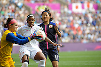 25.07.2012 Coventry, England. Yuki OGIMI (Japan) and Candace CHAPMAN (Canada)challenge for a close ball during the Olympic Football Women's Preliminary game between Japan and Canada from the City of Coventry Stadium