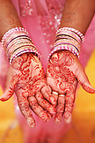 MAURITIUS, mehndi or henna designs cover the hands of women at a Hindu wedding in the town of Surina