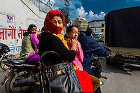 Two wheeled traffic in Kathmandu, Nepal.