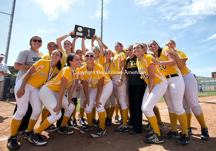 West Haven, CT- 13 June 2015-061315CM20-   The Holy Cross girls softball team celebrate following a 4-0 win over Thomaston to capture the Class S state softball title in West Haven on Saturday.  Christopher Massa Republican-American
