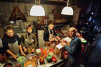 Artigiani a San Lorenzo , quartiere storico di Roma..Andrea Moraes produzione artigianale di candele , nella sua bottega insieme al fratello e alla madre..Andrea Moraes craft production of candles in his shop with his brother and mother..