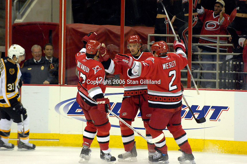 The Carolina Hurricanes' Justin Williams (11) celebrates his goal against the Boston Bruins with teammates Glen Wesley (2) and Rod Brind'Amour (17) during an NHL hockey game Saturday, Dec. 2, 2006 in Raleigh, N.C. Carolina won 5-2.<br />