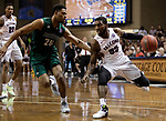 SIOUX FALLS, SD: MARCH 25:  Shammgod Wells #55 of Fairmont State drives on Anthony Woods #20 of Northwest Missouri State during the Men's Division II Basketball Championship game on March 25, 2017 at the Denny Sanford Premier Center in Sioux Falls, SD. (Photo by Dick Carlson/Inertia)