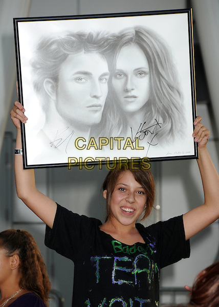 "FANS.""The Twilight Saga: Eclipse"" Los Angeles Premiere at the 2010 Los Angeles Film Festival held at Nokia Theatre LA Live,  Los Angeles, California, USA, 24th June 2010 .signs sign banner fan posters atmosphere portrait of Robert pattinson and Kristen Stewart picture drawing autographed autographs half length .CAP/ADM/BP.©Byron Purvis/AdMedia/Capital Pictures."