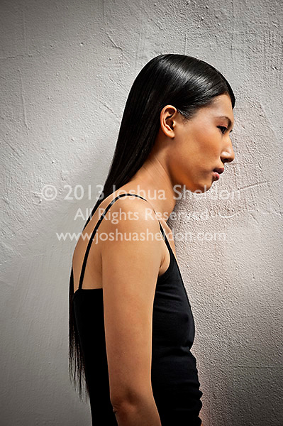 Profile view of young Asian woman