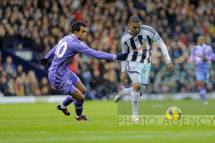 Jerome Thomas of West Bromwich Albion competes with Sandro of Tottenham Hotspur (left).