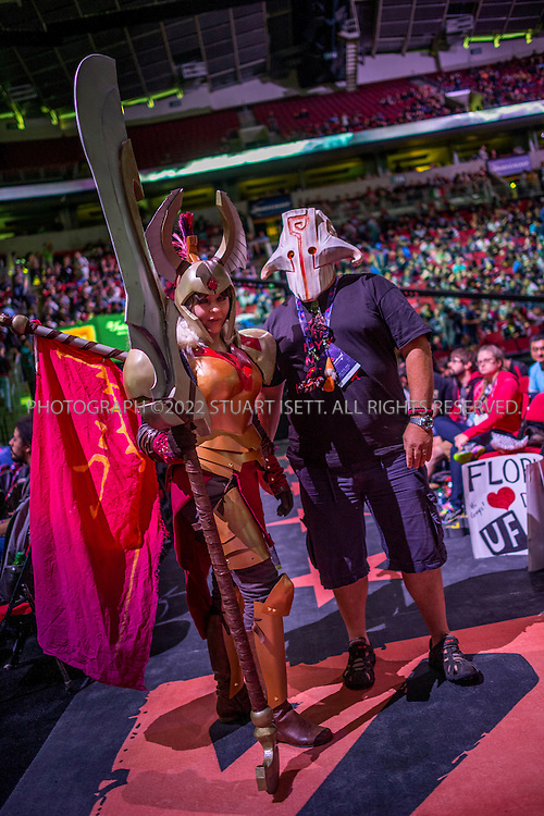 7/21/2014&mdash;Seattle, WA, USA<br /> <br /> Here: Fans of DOTA 2 pose while dressed as their favorite characters during  break in the finals. Vici Gaming lost the best of five final to Newbee, 3 games to 1.<br /> <br /> <br /> &quot;The International&quot; is a video-game tournament hosted by Valve, a game maker based in Bellevue, WASH., with a prize pool reaching $10.8 million. this year the event was held at Key Arena in Seattle, WASH.<br /> <br /> Contestants were playing Dota 2, a 2013 multiplayer online battle arena video game developed by Valve. Five players are on each team, with teams traveling for around the world to battle at the sold-out event.<br /> <br /> <br /> Photograph by Stuart Isett<br /> &copy;2014 Stuart Isett. All rights reserved.