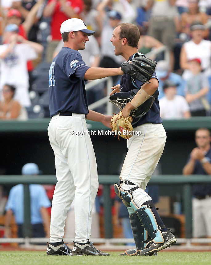 North Carolina catcher Jacob Stallings celebrates with pitcher Kent Emanuel after eliminating Texas. The freshman's 3-0 win was the first complete-game shutout at the College World Series in five years. (Photo by Michelle Bishop)..