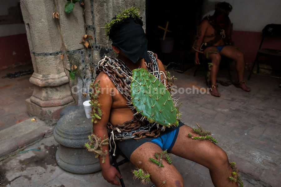 A hooded Catholic penitent, wearing chains and a large cactus stuck to his body, prepares to take part in the Holy week procession in Atlixco, Mexico, 30 March 2018. Every year on Good Friday, dozens of anonymous men of all ages voluntarily undergo pain and suffering during the religious procession of the 'Engrillados' (the Shackled ones) in Puebla state, central Mexico. Wearing heavy chains on their shoulders covered with prickling cacti while being burned by the hot midday sun, they recall Jesus Christ's death by crucifixion and demonstrate their religiosity and faith.