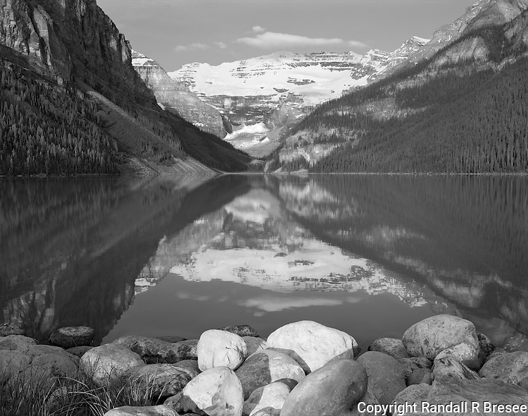 &quot;Lake Louise&quot; Banff National Park; Alberta, Canada<br /> <br /> A popular destination for many visitors to Banff Park is Lake Louise. The lake is flanked by gorgeous mountains and offers views of Victoria Glacier at one end of the lake (far center in this photo). The camera was positioned on the shoreline close to the parking lot to make this black and white photograph shortly after sunrise.
