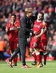 Liverpool's Jurgen Klopp celebrates with Andy Robertson during the premier league match at the Anfield Stadium, Liverpool. Picture date 19th August 2017. Picture credit should read: David Klein/Sportimage