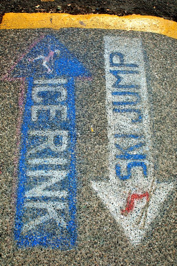 Painted signs on the sidewalk in Steamboat Springs, Colorado. © Michael Brands. 970-379-1885.