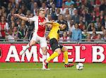 Nederland, Amsterdam, 2 mei 2012.Eredivisie .Seizoen 2011-2012.Ajax-VVV Venlo (2-0).Maya Yoshida van VVV Venlo en Kolbeinn Sigthorsson van Ajax strijden om de bal.
