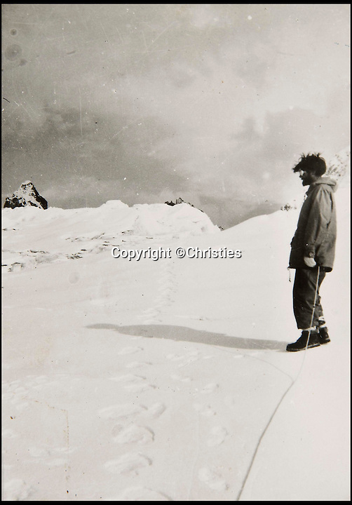 BNPS.co.uk (01202 558833)<br /> Pic: Christies/BNPS<br /> <br /> A picture showing an explorer in the Himalayas.<br /> <br /> The first photographs showing what is believed to be the famous 'Yeti' have emerged for sale.<br /> <br /> British explorer Eric Earle Shipton took the historical pictures in 1951 when he was trekking at 19,000ft in the Himalayas.<br /> <br /> He spotted the mysterious 13-inch footprint in the snow and his iconic photograph caused a global stir, which has divided explorers and historians for decades.