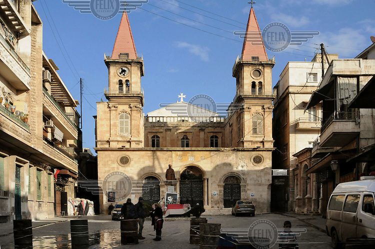 An Orthodox Catlolic cathedral, on the frontline, that has been damaged by opposition shells. Hamdaniya is a heavily battle-damaged suburb on the city's outskirts.