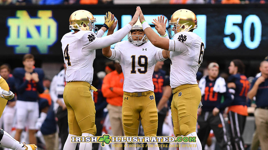 Notre Dame Fighting Irish holder Montgomery VanGorder (4) kicker Justin Yoon (19) and long snapper Scott Daly (61) celebrate after a field goal in the fourth quarter.
