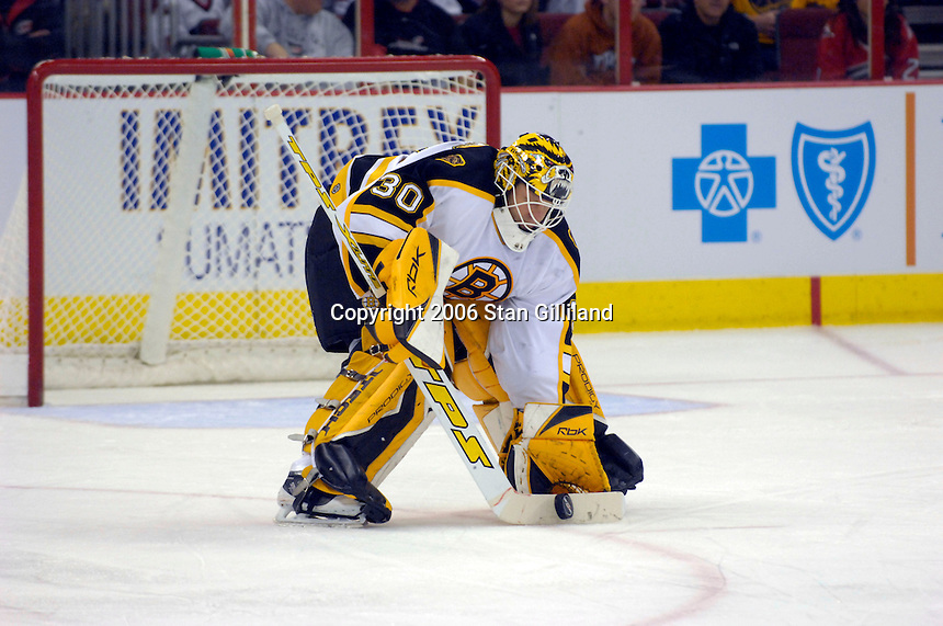 The Boston Bruins' Tim Thomas stops a puck during an NHL hockey game with the Carolina Hurricanes Saturday, Dec. 2, 2006 in Raleigh, N.C. Carolina won 5-2.<br />