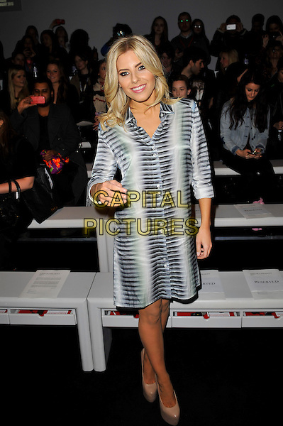 Mollie King of The Saturdays.attending the Aminaka Wilmont a/w 2013 catwalk show during London Fashion Week, Somersert House, London, England. .19th February 2013.LFW full length white grey gray pattern shirt dress platform beige shoes hand arm blue green black.CAP/MAR.© Martin Harris/Capital Pictures.