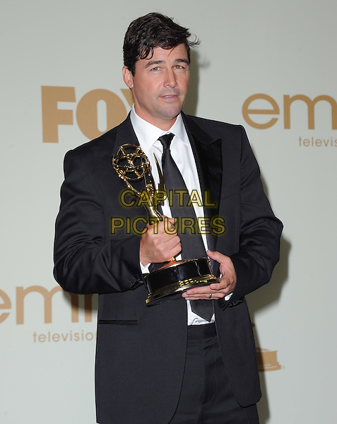 Kyle Chandler.The 63rd Anual Primetime Emmy Awards held at Nokia Theatre L.A. Live in Los Angeles, California, USA..September 18th, 2011.half length award trophy winner black white tie suit.CAP/RKE/DVS.©DVS/RockinExposures/Capital Pictures.
