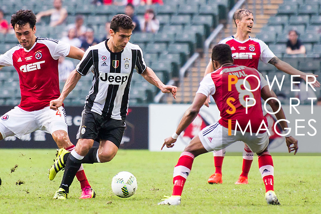 Juventus' player Anderson Hernanes de Carvalho Viana Lima contests the ball against South China's player Mahama Awai during the South China vs Juventus match of the AET International Challenge Cup on 30 July 2016 at Hong Kong Stadium, in Hong Kong, China.  Photo by Marcio Machado / Power Sport Images