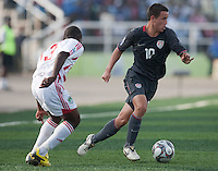 Luis Gil dribbles the ball ahead of Francis Mulimbika. US Men's National Team Under 17 defeated Malawi 1-0 in the second game of the FIFA 2009 Under-17 World Cup at Sani Abacha Stadium in Kano, Nigeria on October 29, 2009.