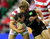 PICTURE BY CHRIS MANGNALL /SWPIX.COM...Rugby League - Super League  - Wigan Warriors v Bradford Bulls - DW Stadium, Wigan, England  - 29/06/12... Wigan's Logan Tomkins tackles Bradford's Brett Kearney