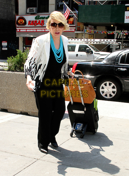 July 02, 2014: Joan Rivers arriving to Penn Station in New York. <br /> CAP/MPI/RW<br /> &copy;RW/ MediaPunch/Capital Pictures
