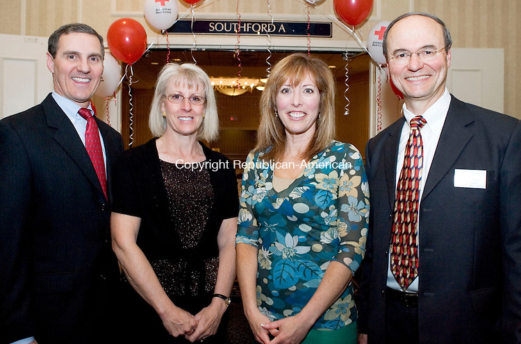 SOUTHBURY, CT- 04 MAY 2008- 050408JT21-<br /> From left, Marc and Susan Vallario with ESPN anchor Linda Cohn and Red Cross board member and event chairman Ray Coulombe during the American Red Cross' &quot;Images of Heroes&quot; gala on Saturday, May 3 at the Crowne Plaza in Southbury. Other award recipients were Jesse Giguere with Global Impact, Kendrik Lechner with Good Samaritan (youth), Meghan Edwards with Good Samaritan (adult), and Laura Coffin with Community Impact.<br /> Josalee Thrift / Republican-American