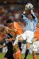 United goalie Troy Perkins snags this ball away from Brian Ching. D.C. United defeated the Houston Dynamo 2-0 at RFK Stadium in Washington, D.C. on April 15, 2006