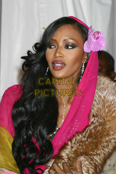 NAOMI CAMPBELL.Royal Birthday Ball for Sean P. Diddy Combs - Inside Arrivals.Cipriani's, New York City, New York .November 4, 2004.headshot, portrait, flower, hair accessory, head scarf, fur.www.capitalpictures.com.sales@capitalpictures.com.© Capital Pictures.com