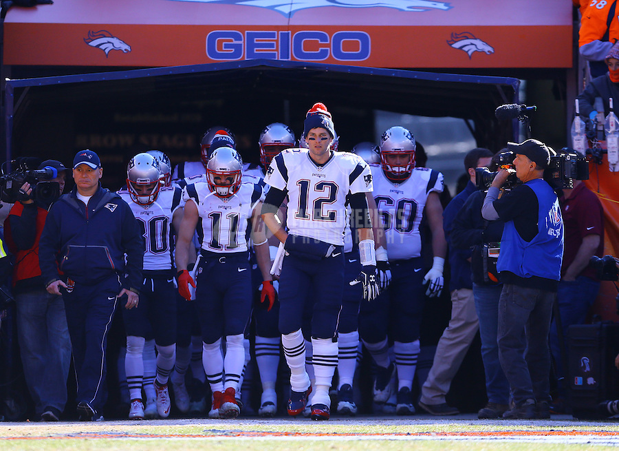 Jan 24, 2016; Denver, CO, USA; New England Patriots quarterback Tom Brady (12) leads his team to the field before the AFC Championship football game against the Denver Broncos at Sports Authority Field at Mile High. Mandatory Credit: Mark J. Rebilas-USA TODAY Sports